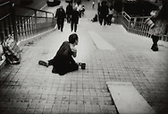 """Man, who lost his arm in an industrial accident, is reduced to begging, Shenzhen, China.  Though there is great opportunity in coastal cities in China, not everyone attains the """"Chinese Dream"""" of prosperity, especially if seriously injured on the job."""