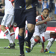 D.C. United Defender JAMES RILEY (2), (Right) looks on and discuss as Philadelphia Union Forward CONOR CASEY (6) celebrates after scoring in 75th minute in a MLS regular season match against D.C. United Saturday. August. 10, 2013 at PPL Park in Chester PA.