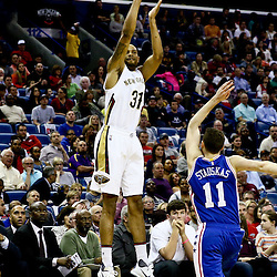 Feb 19, 2016; New Orleans, LA, USA; New Orleans Pelicans guard Bryce Dejean-Jones (31) shoots over Philadelphia 76ers guard Nik Stauskas (11) during the second quarter of a game at the Smoothie King Center. Mandatory Credit: Derick E. Hingle-USA TODAY Sports