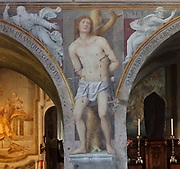 Martyrdom of St Sebastian, detail, below the Passion and Crucifixion of Christ, Renaissance fresco, 1529, by Bernardino Luini, 1480-1532, in the church of Santa Maria Degli Angioli, Lugano, Ticino, Switzerland. The fresco is painted on the dividing wall between the nave and chancel, this detail being on a pillar between the arches. The church was built 1499-1500 as part of the monastery of the Order of Franciscan Friars and was consecrated in 1515. Picture by Manuel Cohen