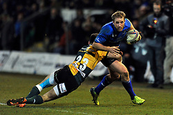 Luke Fitzgerald (Leinster) is tackled by Tom Collins (Northampton) - Photo mandatory by-line: Patrick Khachfe/JMP - Tel: Mobile: 07966 386802 07/12/2013 - SPORT - RUGBY UNION -  Franklin's Gardens, Northampton - Northampton Saints v Leinster - Heineken Cup.