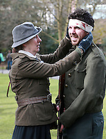 """""""Rebel """" Oisin Mc Kiernan pictured with his Mum Eibhlin, both from Clondalkin, as she tends to his wounds during an enactment of the rising in Dublin's St Stephens Green. Picture Credit:Frank Mc Grath<br /> 28/3/16"""