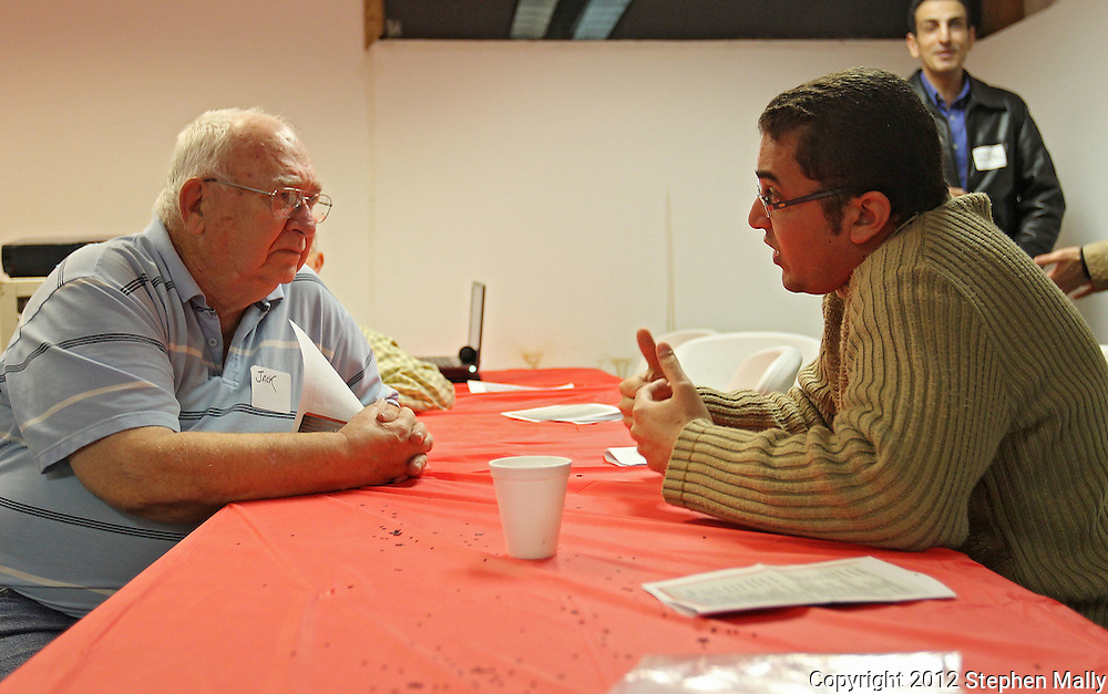 Jack McDermott (from left), of Toddville, talks with Husam Habeeb, of Cedar Rapids, at the celebration of the first anniversary of the Egyptian revolution for democracy at the Muslim American Society, 2121 North Towne Lane NE in Cedar Rapids on Wednesday evening, January 25, 2012. Habeeb was in Egypt during the revolution. The evening's activities included various speakers, a video documentary about the revolution, and a meal. (Stephen Mally/Freelance)
