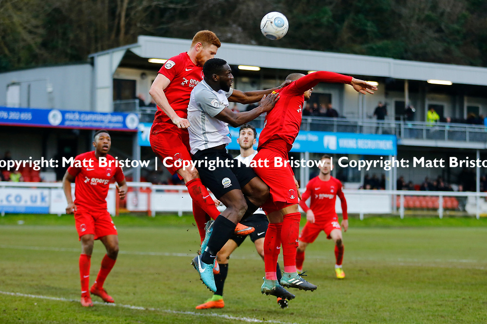 Dover's defender Manny Parry sandwiched between Leyton Orient's defender Myles Judd and Leyton Orient's defender Jake Caprice during the The FA Trophy match between Dover Athletic and Leyton Orient at Crabble Stadium, Kent on 3 February 2018. Photo by Matt Bristow.