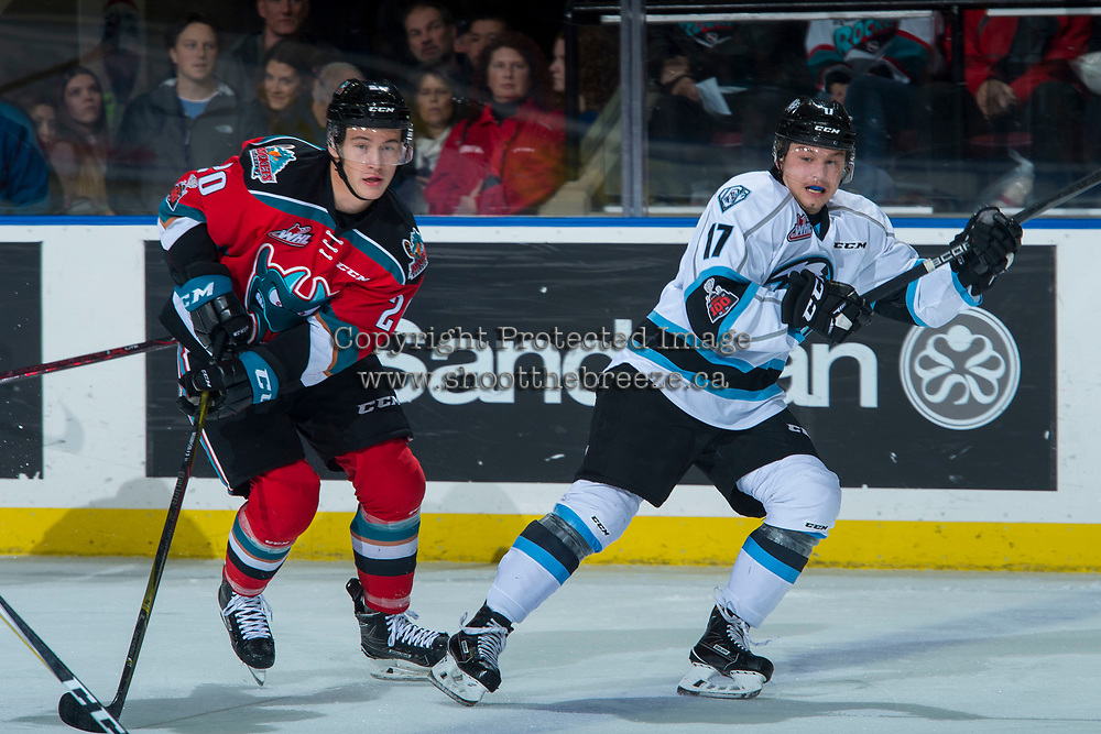 KELOWNA, CANADA - DECEMBER 2: Conner Bruggen-Cate #20 of the Kelowna Rockets back checks Gilian Kohler #17 of the Kootenay Ice during first period on December 2, 2017 at Prospera Place in Kelowna, British Columbia, Canada.  (Photo by Marissa Baecker/Shoot the Breeze)  *** Local Caption ***