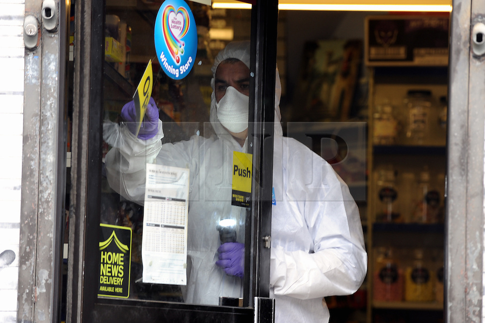 © Licensed to London News Pictures. 16/08/2013<br /> A Kent shopkeeper is in hospital this morning after being attacked and his newsagents robbed.<br /> The robbery took place this morning (16.08.2013) at Number 5, Cray Parade, St Pauls Cray  Newsagents, Main Road, St Pauls Cray, Orpington, Kent.<br /> Police scenes of crime are at the shop taking DNA and finger prints.<br />  Photo credit :Grant Falvey/LNP
