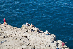 Sorrento, Italy, September 18 2017. People fish off the rocks at il Capo near Sorrento, Italy. © Paul Davey