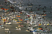 "More than 200 local South African surfers paddle out prior to setting a new Guinness World Record for the ""Most surfers standing on one wave"" at Muizenberg Corner, Cape Town South Africa Sunday 17 September 2006. After several attempts the record was broken by 73 surfers riding the same wave. Results, beating the last record of 53 in Bali must still be ratified by Guiness."