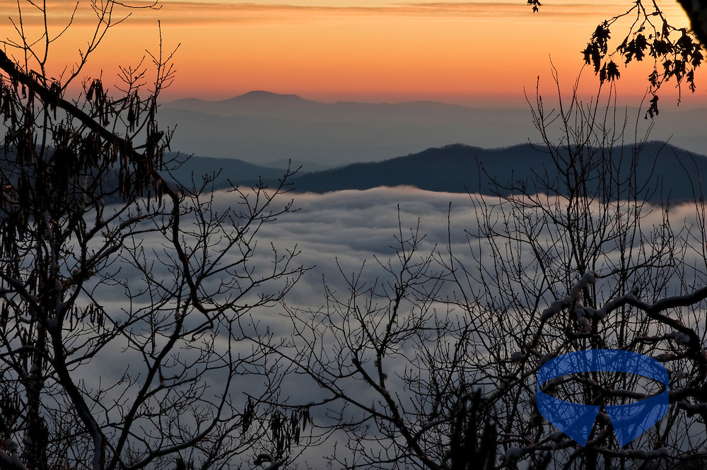 Sunrise and low clouds and fog in the Pisgah National Forest in North Carolina (NC) as seen from  Old Butt Knob.