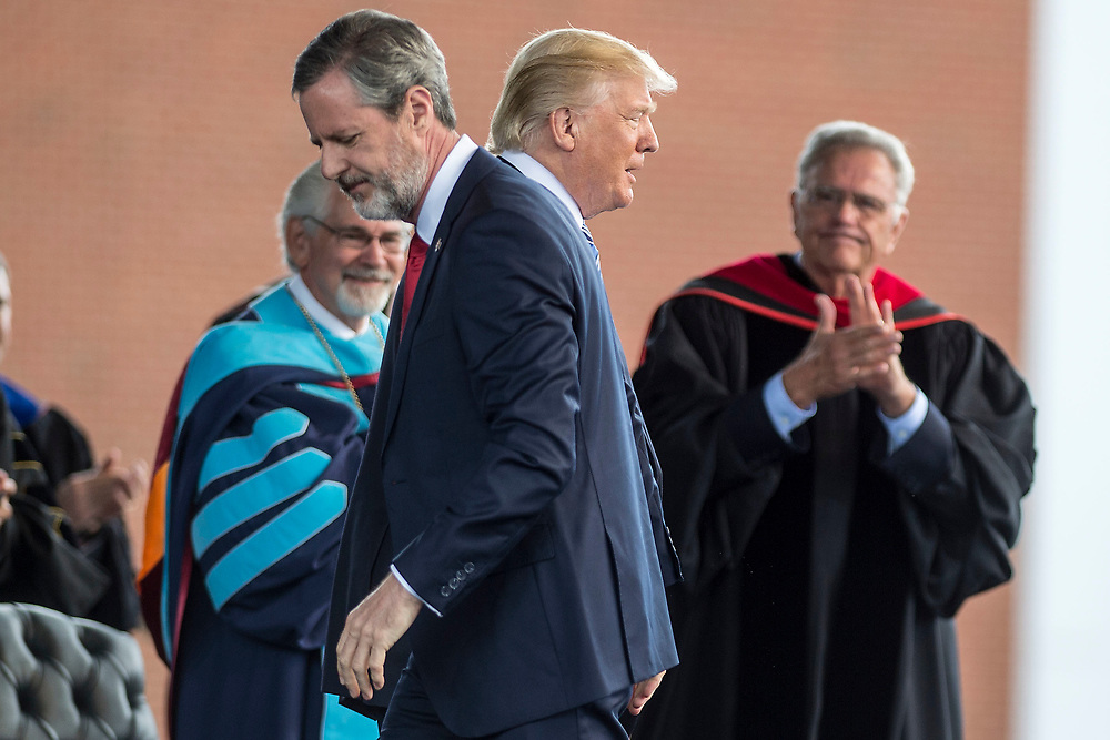 LYNCHBURG, VA - MA7 13: President Donald Trump walks to the podium after being introduced by Liberty University President Jerry Falwell Jr. on Saturday, May 13, 2017 in Lynchburg, Va. (Photo by Jay Westcott/The News & Advance)