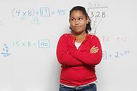 Pensive Schoolgirl against whiteboard