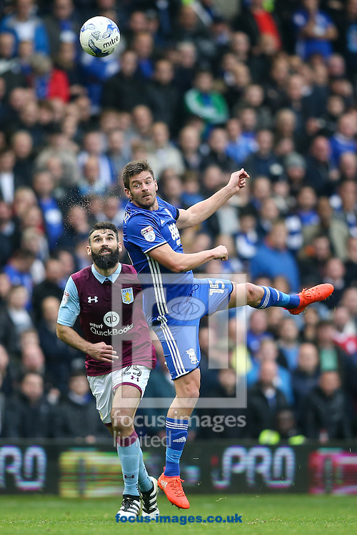 Lukas Jutkiewicz of Birmingham City (right)  heads forwards during the Sky Bet Championship match at St Andrews, Birmingham<br /> Picture by Andy Kearns/Focus Images Ltd 0781 864 4264<br /> 30/10/2016