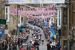 The peloton rides through Pateley Bridge during the Tour de Yorkshire - a 122.5 km road race, between Tadcaster and Harrogate on April 29, 2017, in Yorkshire, United Kingdom.