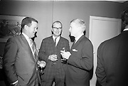 "4/03/1966<br /> 03/24/1966<br /> 24 March 1966<br /> Reception at the Shelbourne Hotel for speakers at the Symposium on ""Shock"" sponsored by Pharmacia International held at UCD. Image shows (l-r): Mr Don Douglas, Representative of Pharmacia International; Professor E. O'Malley, M.Ch., M.Sc., F.R.C.S.I. andDr K. Skagius, Director of Research, Pharmacia International."