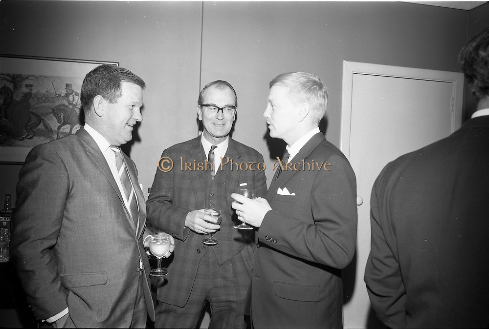 """4/03/1966<br /> 03/24/1966<br /> 24 March 1966<br /> Reception at the Shelbourne Hotel for speakers at the Symposium on """"Shock"""" sponsored by Pharmacia International held at UCD. Image shows (l-r): Mr Don Douglas, Representative of Pharmacia International; Professor E. O'Malley, M.Ch., M.Sc., F.R.C.S.I. andDr K. Skagius, Director of Research, Pharmacia International."""