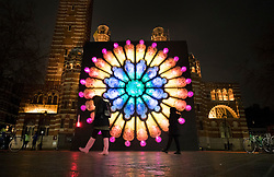 © Licensed to London News Pictures. 17/01/2018. London, UK. A bicycle powered illuminated installation entitled 'The Rose' ?by Mick Stephenson stands in front of Westminster Cathedral during the Lumiere London festival. Running from 18th-21st January 2018 more than 50 artworks are transforming the capital's streets, buildings and public spaces into an immersive nocturnal art exhibition of light and sound. Locations include King's Cross, Fitzrovia, Mayfair, West End, Trafalgar Square, Westminster, Victoria, South Bank and Waterloo. Photo credit: Peter Macdiarmid/LNP