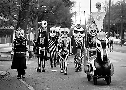 17 Feb 2015. New Orleans, Louisiana.<br /> Mardi Gras Day. Walking with Skeletons. <br /> The Skeleton Krewe meets before dawn beside a cemetery in Uptown New Orleans. They then walk several miles to the French Quarter to celebrate Mardi Gras Day.<br /> Photo; Charlie Varley/varleypix.com