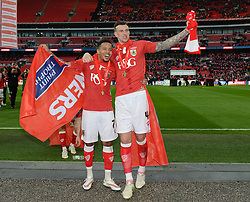 Bristol City's Korey Smith and Bristol City's Aden Flint celebrate the win over Walsall in the Johnstone Paint Trophy final - Photo mandatory by-line: Dougie Allward/JMP - Mobile: 07966 386802 - 22/03/2015 - SPORT - Football - London - Wembley Stadium - Bristol City v Walsall - Johnstone Paint Trophy Final