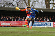 Lyle Taylor of AFC Wimbledon heads and scores a goal during the Sky Bet League 2 match between AFC Wimbledon and Luton Town at the Cherry Red Records Stadium, Kingston, England on 13 February 2016. Photo by Stuart Butcher.