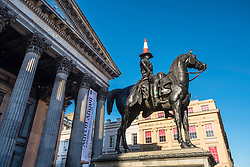 Statue of Wellington on horseback with traffic cone on his head at Gallery of Modern Art in Exchange Square, Glasgow, United Kingdom