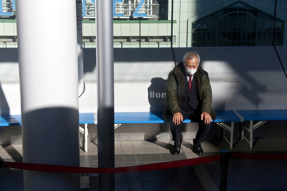 senior businessman sitting alone on a bench Japan Tokyo