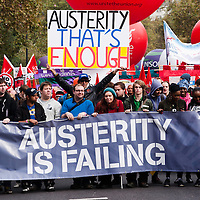London, UK - 20 October 2012: people hold a banner reading 'Austerity is failing' during the TUC-organised march 'A future that works' against austerity cuts in central London.