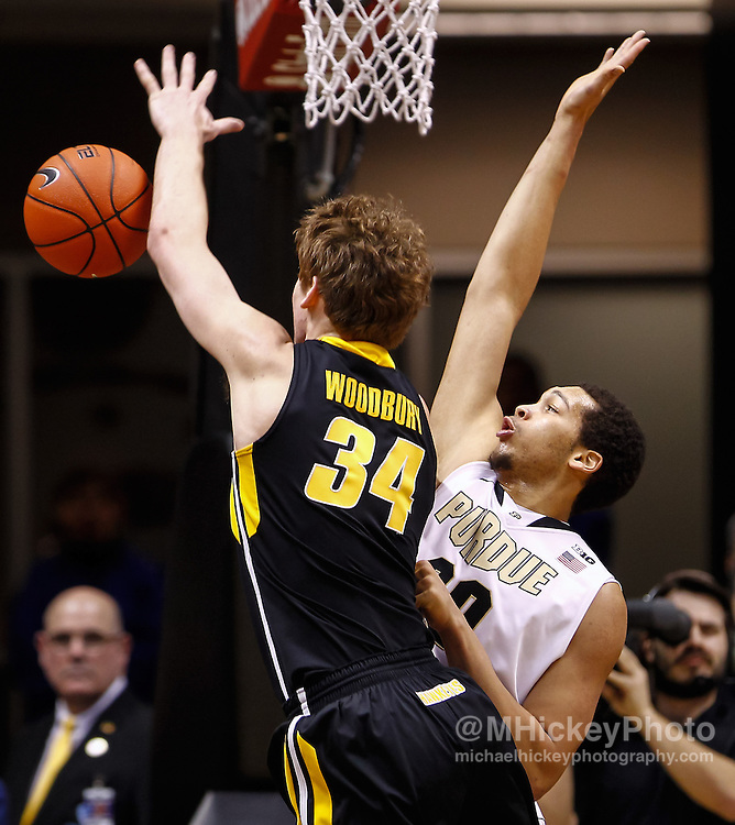 WEST LAFAYETTE, IN - JANUARY 27: Adam Woodbury #34 of the Iowa Hawkeyes loses control of the ball as A.J. Hammons #20 of the Purdue Boilermakers defends at Mackey Arena on January 27, 2013 in West Lafayette, Indiana. Purdue defeated Iowa 65-62 in overtime. (Photo by Michael Hickey/Getty Images) *** Local Caption *** Adam Woodbury; A.J. Hammons