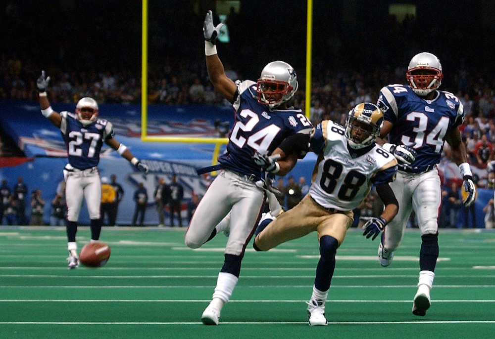 (2/3/02 New Orleans, Lousiana) Super Bowl Patriots vs Rams. Ty Law breaks up a 3rd quarter pass to Rams (88) Torry Holt . (020302patsmjs-Staff photo byMichael Seamans. Saved in photo mon/FTP.)
