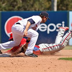 March 13, 2011; Fort Myers, FL, USA; Philadelphia Phillies first baseman John Mayberry Jr. steals second base past Minnesota Twins shortstop Trevor Plouffe (24) during a spring training exhibition game at Hammond Stadium.   Mandatory Credit: Derick E. Hingle