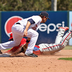 March 13, 2011; Fort Myers, FL, USA; Philadelphia Phillies first baseman John Mayberry Jr. steals second base past Minnesota Twins shortstop Trevor Plouffe (24) during a spring training exhibition game at Hammond Stadium.   Mandatory Credit: Derick E. Hingle