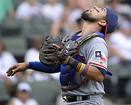 CHICAGO - JULY 02:  Robinson Chirinos #61 of the Texas Rangers catches against the Chicago White Sox on July 2, 2017 at Guaranteed Rate Field in Chicago, Illinois.  The White Sox defeated the Rangers 6-5.  (Photo by Ron Vesely) Subject:   Robinson Chirinos