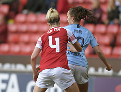 February 23, 2019 - Sheffield, England, United Kingdom - A push in the back for Caroline Weir (Manchester City) from Arsenal's Janni Arnth during the  FA Women's Continental League Cup Final  between Arsenal and Manchester City Women at the Bramall Lane Football Ground, Sheffield United FC Sheffield, Saturday 23rd February. (Credit Image: © Action Foto Sport/NurPhoto via ZUMA Press)