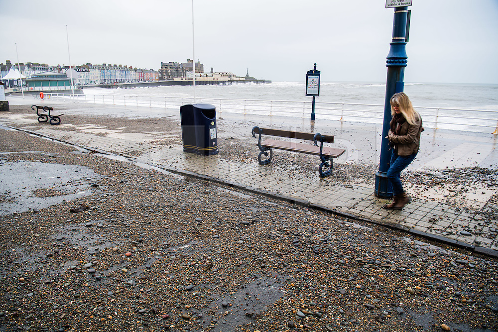 © London News Pictures. 16/12/2016. Aberystwyth, UK.<br /> Shale washed on the the promenade as Large aves to batter the seafront at Aberystwyth, and leaving a trail of sand and stones over the promenade and Marine Terrace road.  Photo credit: Keith Morris/LNP