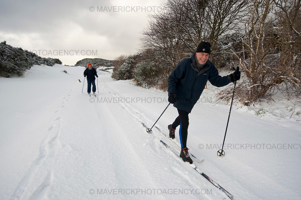 Two cross country skiers enjoy the snowfall on the Braid Hills golf course in Edinburgh.  Heavy snow has fallen across large parts of the UK, disrupting travel and closing thousands of schools.  Weather warnings of heavy and drifting snow are also in place for many southern and eastern parts of Scotland.