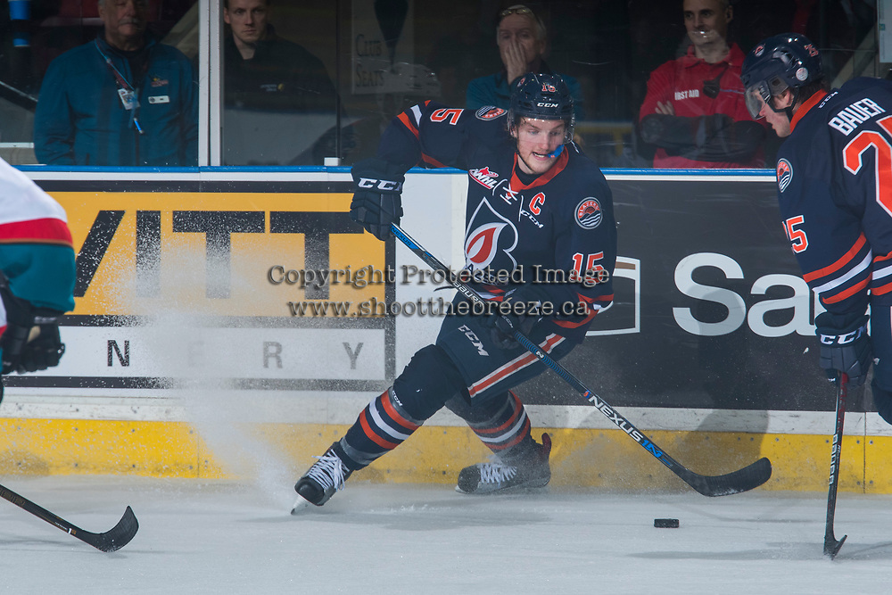KELOWNA, CANADA - MARCH 25: Collin Shirley #15 of the Kamloops Blazers stops on the ice with the puck against the Kelowna Rockets on March 25, 2017 at Prospera Place in Kelowna, British Columbia, Canada.  (Photo by Marissa Baecker/Shoot the Breeze)  *** Local Caption ***