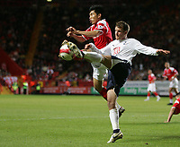 Photo: Lee Earle.<br /> Charlton Athletic v Tottenham Hotspur. The Barclays Premiership. 07/05/2007.Tottenham's Teemu Tainio (R) clashes with Zheng Zhi.
