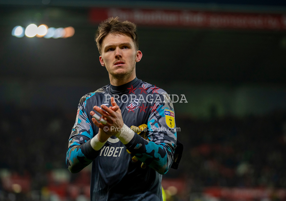 STOKE-ON-TRENT, ENGLAND - Saturday, January 25, 2020: Swansea City's goalkeeper Freddie Woodman applauds the supporters after the Football League Championship match between Stoke City FC and Swansea City FC at the Britannia Stadium. Swansea City lost 1-0. (Pic by David Rawcliffe/Propaganda)