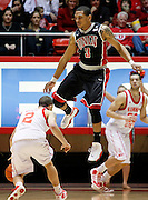 UNLV guard Anthony Marshall (3) avoids fouling Utah guard Chris Kupets (2)during the second half of an NCAA college basketball game in Salt Lake City, Saturday, March. 5, 2011. UNLV defeated Utah 78-58. (AP Photo/Colin E Braley)