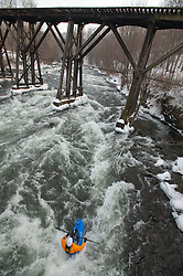Marc Aucoin of Henniker, NH, plays in an eddy in the Winnipesaukee River in Franklin after completing a run through Class IV rapids in the 30th annual New Year's Day kayak run in Franklin on Saturday, January 1, 2011.  (Alan MacRae/for the Monitor)