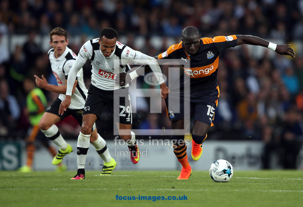 Marcus Olsson of Derby County and Mohamed Diame of Newcastle United during the Sky Bet Championship match at the iPro Stadium, Derby<br /> Picture by Christopher Booth/Focus Images Ltd 07711958291<br /> 10/09/2016