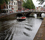 Typically Dutch view of boat and canal bridge, Leiden, Netherlands