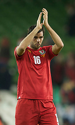 DUBLIN, IRELAND - Tuesday, February 8, 2011: Wales' Joe Ledley looks dejected as he applauds the travelling supporters after losing 3-0 to the Republic of Ireland during the opening Carling Nations Cup match at the Aviva Stadium (Lansdowne Road). (Photo by David Rawcliffe/Propaganda)