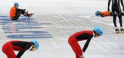 21-02-2014 SHORTTRACK: OLYMPIC GAMES: SOTSJI<br /> Grote teleurstelling bij de mannen op de relay. In de eerste bocht ging Nederland al onderuit / Niels Kersholt en Daan Breeuwsma zit/ligt verslagen op het middenterrein<br /> ©2014-FotoHoogendoorn.nl