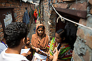 Community fieldstaff from LaborVoices out talking to garment workers in Dhaka Bangladesh<br /> <br /> They are introducing them to SmartLine, which allows garment workers to share feedback on their safety and working conditions, quickly and anonymously via their mobile phone.<br /> <br /> The SmartLine provides brands and suppliers real-time visibility into factory conditions, enabling them to identify and solve problems before they become urgent.