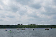 Kayaks and canoes take to Hundred Acre Pond at the Adirondack Mountain Club's Outdoor Expo at Mendon Ponds Park on Saturday, June 11, 2016.