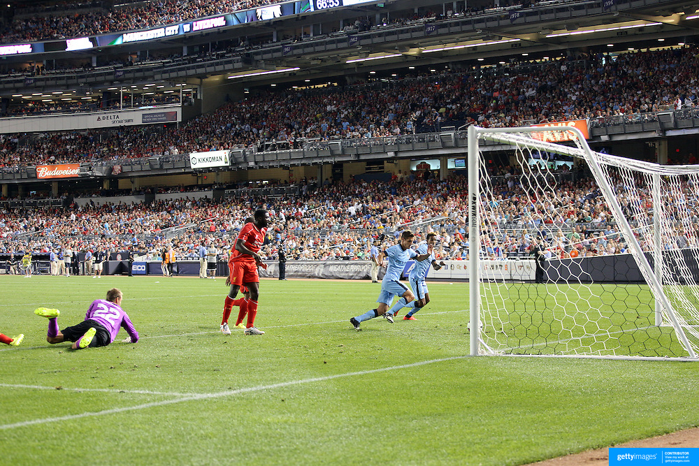Stevan Jovetic, (out of picture), Manchester City, scores his sides second goal during the Manchester City Vs Liverpool FC Guinness International Champions Cup match at Yankee Stadium, The Bronx, New York, USA. 30th July 2014. Photo Tim Clayton