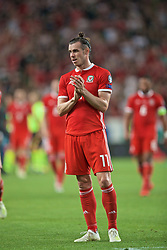 BUDAPEST, HUNGARY - Tuesday, June 11, 2019: Wales' Gareth Bale applauds the travelling supporters after the UEFA Euro 2020 Qualifying Group E match between Hungary and Wales at the Ferencváros Stadion. Hungary won 1-0. (Pic by David Rawcliffe/Propaganda)