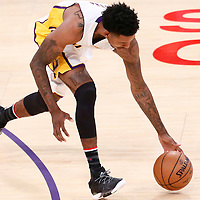 06 November 2016: Los Angeles Lakers guard Nick Young (0) reaches for the ball during the LA Lakers 119-108 victory over the Phoenix Suns, at the Staples Center, Los Angeles, California, USA.