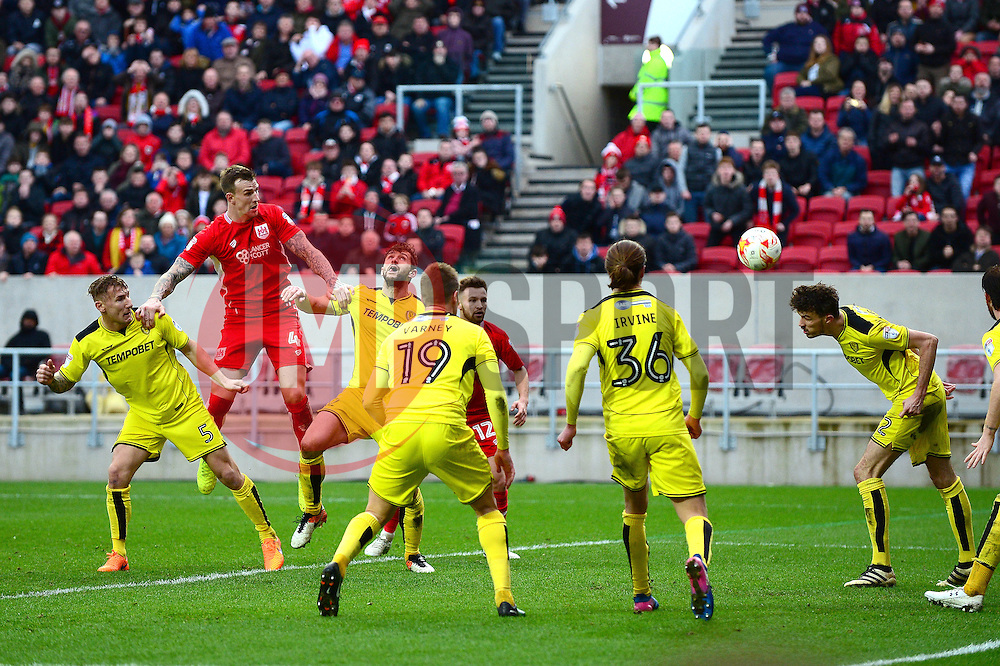Aden Flint of Bristol City heads towards goal which is cleared by Tom Flanagan of Burton Albion - Mandatory by-line: Dougie Allward/JMP - 04/03/2017 - FOOTBALL - Ashton Gate - Bristol, England - Bristol City v Burton Albion - Sky Bet Championship