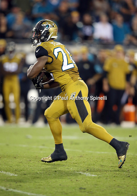 Jacksonville Jaguars running back T.J. Yeldon (24) takes a handoff on a fourth quarter running play during the 2015 week 11 regular season NFL football game against the Tennessee Titans on Thursday, Nov. 19, 2015 in Jacksonville, Fla. The Jaguars won the game 19-13. (©Paul Anthony Spinelli)